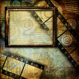 Grungy art. Trendy background in grunge style with  frame and film strips Stock Images