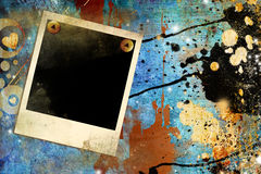 Grungy art. Artwork in grunge style with paint splats and polaroid frame Stock Photos