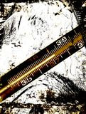 Grungy background. Celsius thermometer Royalty Free Stock Photo