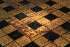 Grungy background. Grungy vintage retro floor with tiles, traces of rust Stock Image