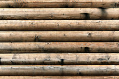 Grungy background of cylindrical logs Stock Photography