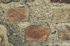 Grungy bakgrund och textur för otvungenhettegelstenvägg Arkivbilder