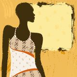 Grungy banner with an African woman in a patterned Royalty Free Stock Image