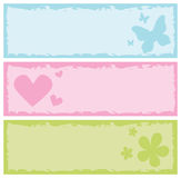 Grungy banners with butterflies, hearts, flowers Stock Images