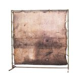 Grungy blank canvas. Blank worn canvas and stand, free copy space,grunge, isolated on whote background, clipping path Royalty Free Stock Photography