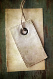 Grungy blank tag and paper Stock Photo