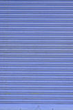 Grungy blue corrugated metal sheet slide door Royalty Free Stock Photography