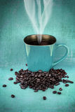 Grungy blue green cup of coffee Stock Images