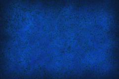Grungy blue mottled background texture Stock Images