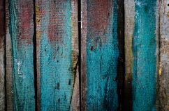 Grungy blue and red pealing paint wooden wall texture.  Stock Images