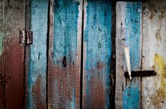 Grungy blue and red pealing paint wooden wall texture.  Royalty Free Stock Photos