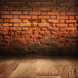 Grungy brick wall with wooden floor Stock Images