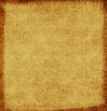 Grungy brown background. Grungy brown canvas with  floral pattern and space for text or picture Stock Images