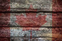 Grungy Canadian flag on a wall. Grungy and faded Canadian flag on a wall Royalty Free Stock Photo
