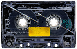 Grungy Cassette. Dirty, scratched and grungy retro cassette tape with a blank label Stock Photo