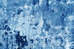 Grungy cement wall in navy blue tone. Stock Photo