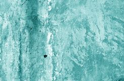 Grungy cement wall texture in cyan tone. Abstract architectural background and texture for design stock photography