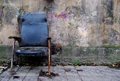 Grungy chair. Old chair on a grungy background Stock Photos