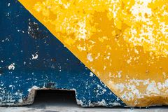 Grungy concrete road block, yellow and blue stock images