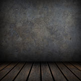 Grungy concrete and wood wall and floor. Stock Photo
