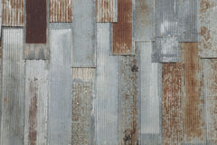 Grungy corrugated steel wall with rusty spots on an old building Royalty Free Stock Image