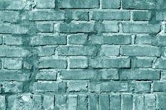 Grungy cyan tonad textur för tegelstenvägg Arkivbilder