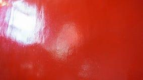 Grungy czerwień wykładająca marmurem żebrował beton malującego ściennego tło Fotografia Stock