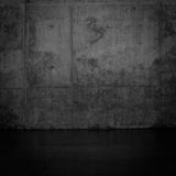 Grungy dark concrete wall and wet floor Stock Image