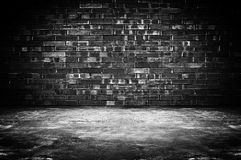 Grungy dark room background. Old dark room with brick wall and concrete floor - as background Stock Photo
