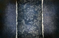 Grungy denim with faded floral effect Royalty Free Stock Images