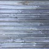 Grungy distressed grey wooden textured fence. With vertical panels Royalty Free Stock Image