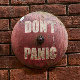 Grungy Dont Panic Bell Royalty Free Stock Photos