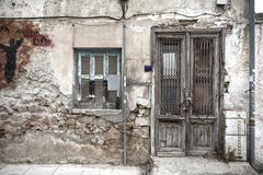 Grungy facade of an old house in Athens Stock Photo