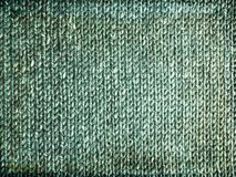 Grungy faded green knitted background Royalty Free Stock Image