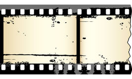 Grungy film strip. Two frames of grungy film strip in editable vector Stock Image