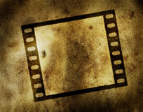 Grungy film strip. Background, on an old parchment Stock Photos