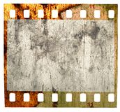 Grungy Filmstrip, battered, isolated. Battered grungy 35mm slide, scratches, grotty and spotty Royalty Free Stock Photography