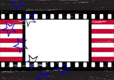 Grungy filmstrip frame. Stars and stripes over grungy stylized filmstrip Stock Photography
