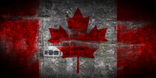Grungy Flag of Canada on stone texture background closeup. Grungy Flag of Canada on stone texture background Royalty Free Stock Image
