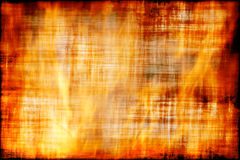 Grungy flame. Ancient parchment is burning in flame/ textured fire background Stock Images
