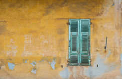 Grungy french widow shutters wall. Old grungy wall and window shutters in old town Nice,France Royalty Free Stock Photography