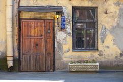 Grungy front door of residential house in Russia Stock Photos