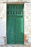 Grungy front door. Weathered green front door of an old stone house at south Pelion, Greece Royalty Free Stock Image