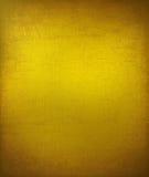 Grungy gebarsten gele geweven achtergrond stock foto