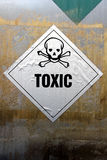 Grungy giftlig etikett Royaltyfria Bilder