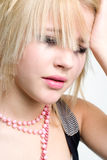 Grungy girl in despair. Crying emo girl with headache closeup portrait Royalty Free Stock Image