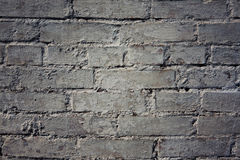Grungy gray background of bricks and cement old wall texture. Grungy gray background of bricks and cement old wall texture with light spot in the center. It is Stock Photo