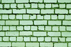 Grungy green color brick wall pattern. Royalty Free Stock Images