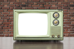Grungy Green Vintage Television with Brick Wall and Cut Out Scre Royalty Free Stock Photography