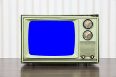 Grungy Green Vintage Television with Chroma Key Blue Screen. Grungy green vintage television set with chroma key blue screen Royalty Free Stock Images